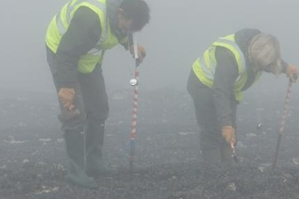 Coastbuster Volunteers in the mist