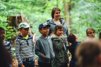Children and families outdoors in woodland, photo by Helena Dolby for Sheffield & Rotherham Wildlife Trust