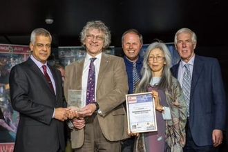Queendown Warren Green Team receiving their environmental volunteers of the year award