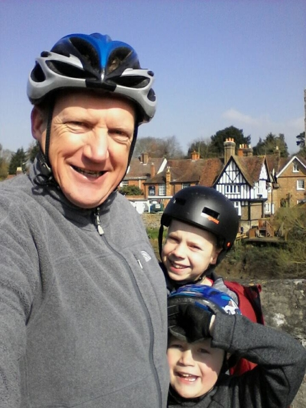 Ed and his sons on their sunny cycling adventure