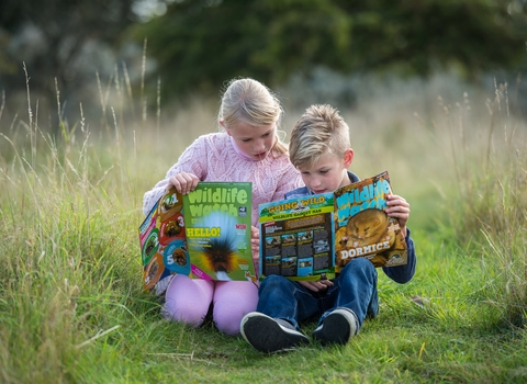 Children reading Wildlife Watch magazine - photo by Matthew Roberts